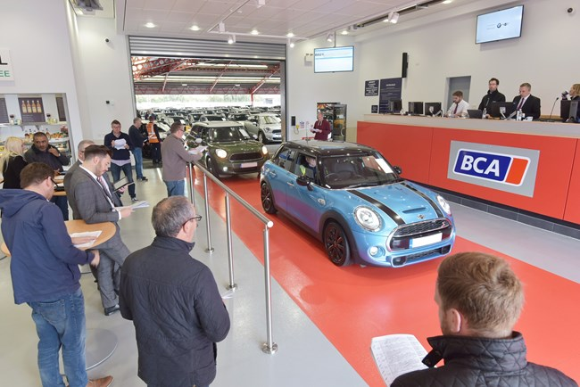 Rising used car volumes and demand reported at auction